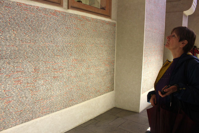 Ana contemplates a wall in one of Prague's Jewish museums that lists the roughly 75,000 Nazi concentration-camp victims who lost their lives in World War II.