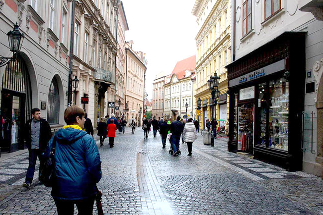 Prague is very walkable - unless you have a foot injury and can't handle cobblestones too well. Ana was so afflicted but soldiered on. Here, she's on Celetna Street in the old town.